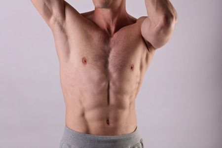 Attractive muscular male body , torso, chest. Healthy shirtless man athlete close up. Sport, Fitness or male Waxing concept.