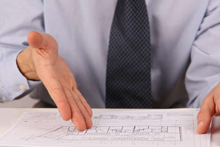 Businessman skeptical reading document close up. Project Manager disagree with floor plan design