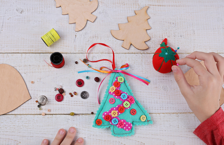 child making felt christmas tree decoration ornament close up kids art art projects - Handmade Felt Christmas Decorations