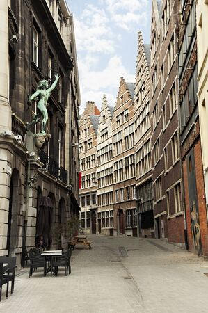Vertical view of narrow old traditional flemish street in centre of Antwerp, Belgium in cloudy day. Antwerpen popular famous travel tourism destination. Buildings and landmarks in Benelux.