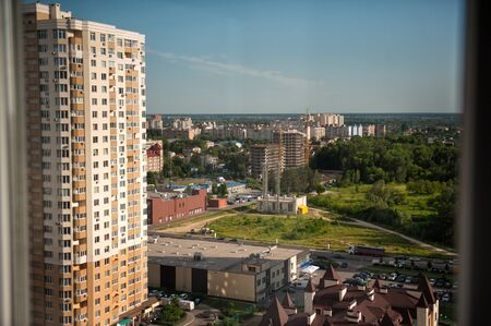 Brovary city view from upper floor of new district. Summer time in city near capital of Ukraine Kyiv. New district construction.