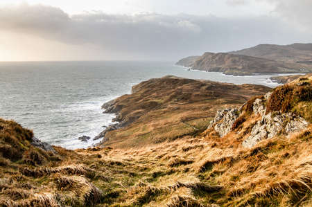 roaring sea: View of mountain and sea in coastline in County Donegal in Ireland. Stock Photo
