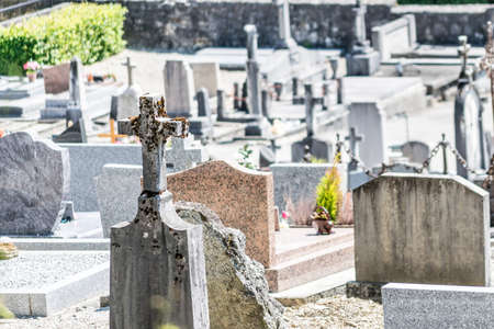 belief system: French graveyard by church.
