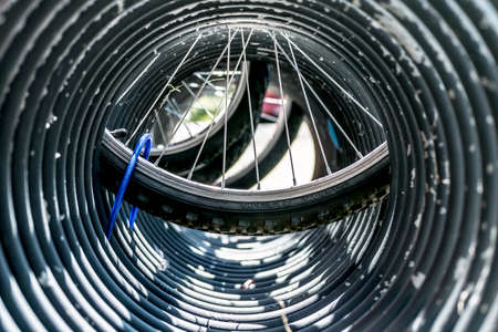 tunnel vision: Bike wheels seen through bike stand in French town.
