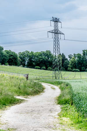 power line transmission: Electric power transmission line in French countryside.