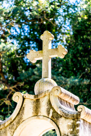 remembering: Stone cross at Greek monastery monument remembering those who have died in a car accident  car crash, in Crete, Greece.