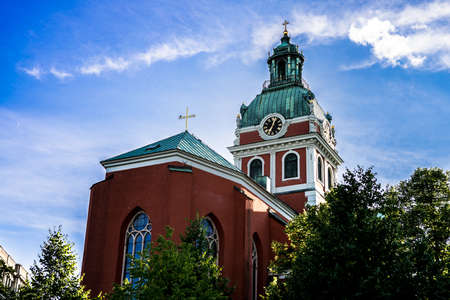 evening church: Protestant church tower in evening light. Stockholm, Sweden.