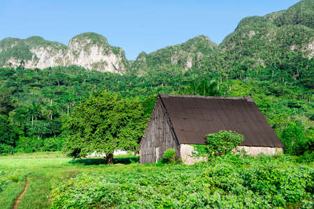 the world heritage: 13 September 2015: Farmers barn on field in the UNESCO world heritage site of Vinales, Cuba.
