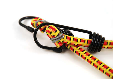elongation: Stock pictures of bungee cords with steel hooks of several colors