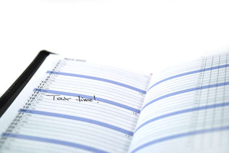 daily planner: daily planner with appointment for doing taxes Stock Photo
