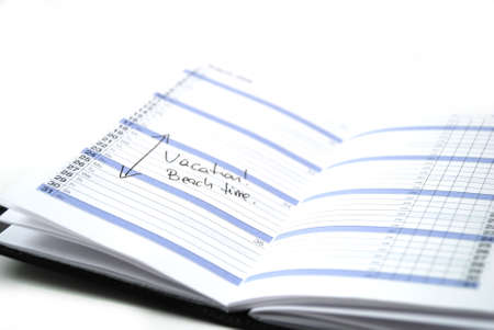scheduled: daily planner showing scheduled vacation time at the beach