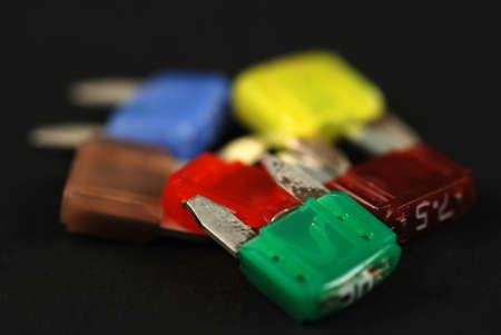electrical automobile fuses with shallow depth of field on black background