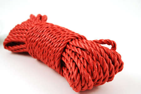 stock picture of a coil and loop of red rope