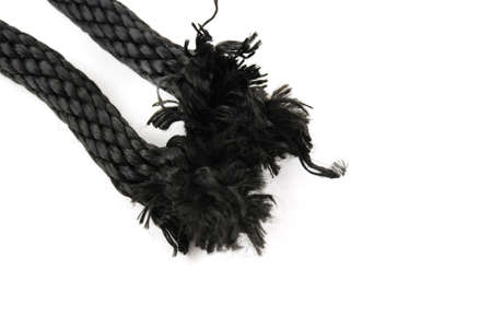 suffocate: stoock pictures of a piece of rope ready to be broken