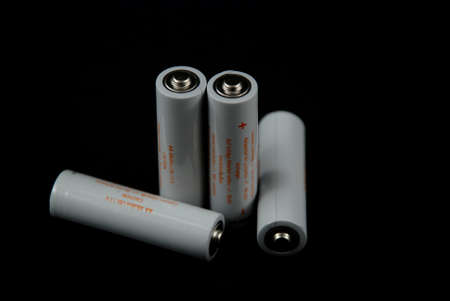 polarity: isolated pictores of electrical batteries on black background