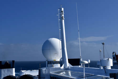 antennas and communication equipment on a cruise ship