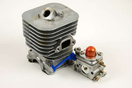 Stock pictures of a small gas engine and a carburetor 스톡 콘텐츠