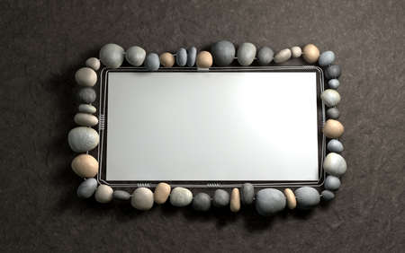 solid wire: A contempory handmade wire and stone picture frame hanging on a wall Stock Photo