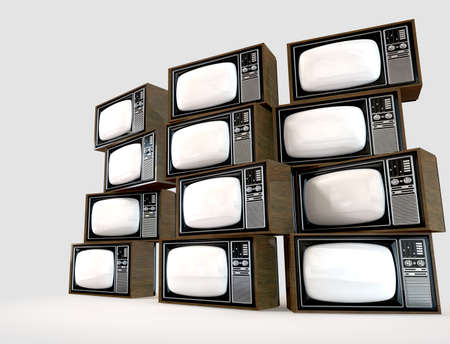 A wall of old vintage tube televisions with wood trim photo