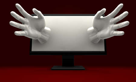 A pair of hands reaching out from a lcd computer monitor encroaching on the user Stock Photo