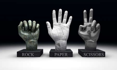 knock out: 3 statuettes showing the hand-game Roshambo, made out of the hand gestures corresponding to the materials of rock, paper and scissors