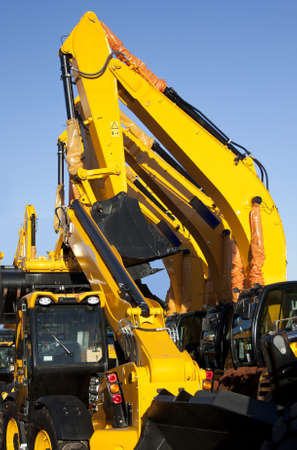earth moving equipment: I line of brand new earth moving equipment in a row