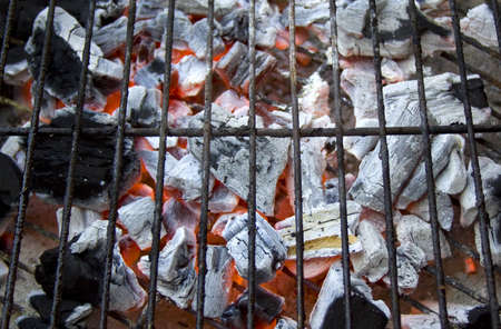 A closeup of a charcoal fuelled barbeque with a steel cooking grid Stock Photo - 13300827