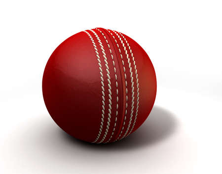 An red leather cricket ball isolated on a white background photo