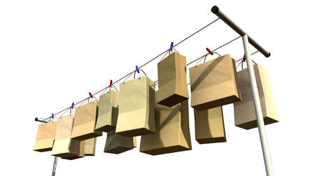 literal: A literal depiction for the saying online shopping, shopping bags hanging on a wash line Stock Photo