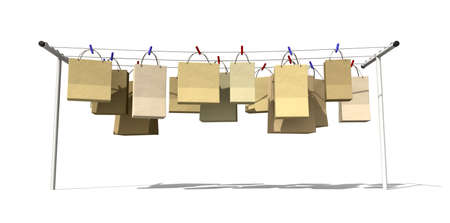 clothes pegs: A literal depiction for the saying online shopping, shopping bags hanging on a wash line Stock Photo