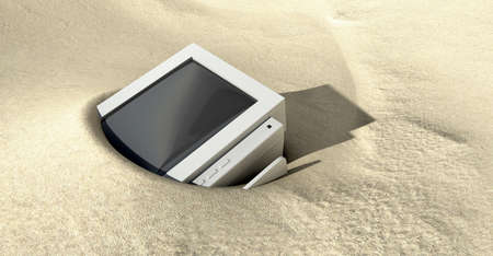 An old tube-type computer monitor discarded and half buried in desert sand Stock Photo - 13622556