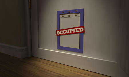 occupied: A humorous look at a pet flap on a white door with an occupied sign across it surrounded by green walls and white skirting Stock Photo
