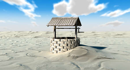 wishing: An old school well isolated in the middle of a vast sandy desert