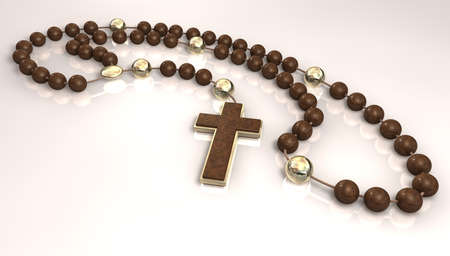 interspersed: A wooden beaded rosary interspersed with gold beads and a wood and gold crucifix