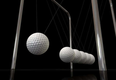 oscillate: A typical newtons cradle in motion with the balls replaced by golf balls