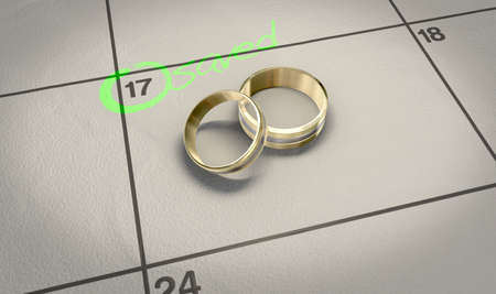 A mens and ladies wedding band resting on a calendar with with the date circled  and the word saved written in highlighter pen Stock Photo - 14253922