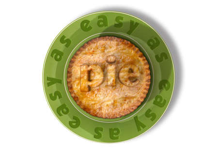 trouble free: A top view of a pie on a green plate with the words easy as written on the plate and pie in pastry on the pie Stock Photo
