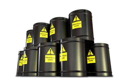 A stack of black metal barrels with yellow hazardous waste labels on each photo