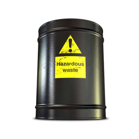 waste products: A  black metal barrel with a yellow hazardous waste label on an isolated background Stock Photo