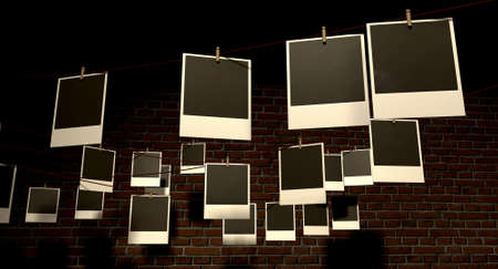 A gallery of blank polaroids pegged onto multidirectional red strings infront of a facebrick wall photo
