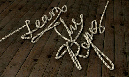 One continuous rope shaped into the words learn the ropes on an wooden background Stock Photo - 14705073