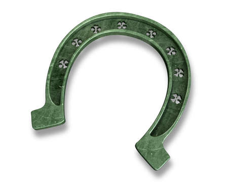 A metal horseshoe with punched out shamrock shapes on an isolated background photo