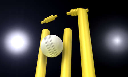 nighttime: A white leather cricket ball hitting yellow cricket wickets in the nighttime Stock Photo