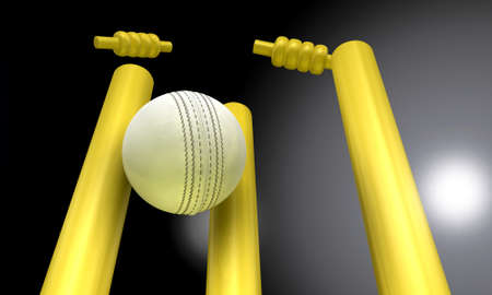 cricket game: A white leather cricket ball hitting yellow cricket wickets in the nighttime Stock Photo
