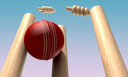 cricket sport: A red leather cricket ball hitting wooden cricket wickets in the daytime