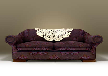 old sofa: An old vintage sofa with a purple floral fabric on an isolated background Stock Photo