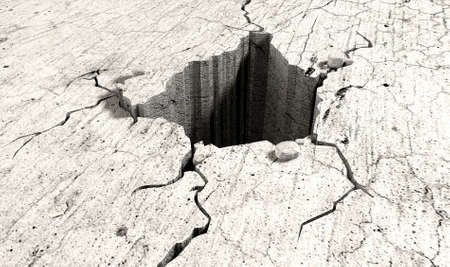 crevice: An infintiely deep hole in a flat piece of cracked stone Stock Photo