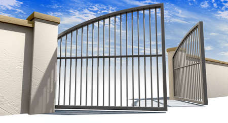 A solid garden wall with open metal gates with a blue sky in the background and isolated on a white foreground photo