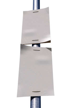 affix:  A front view of a street pole with two blank weathered newspaper headline pages attached to it Stock Photo
