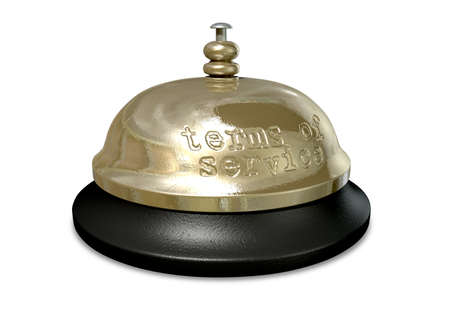 A regular metal and plastic hotel or service bell with the words terms of service punched into the metal Stock Photo - 15409958